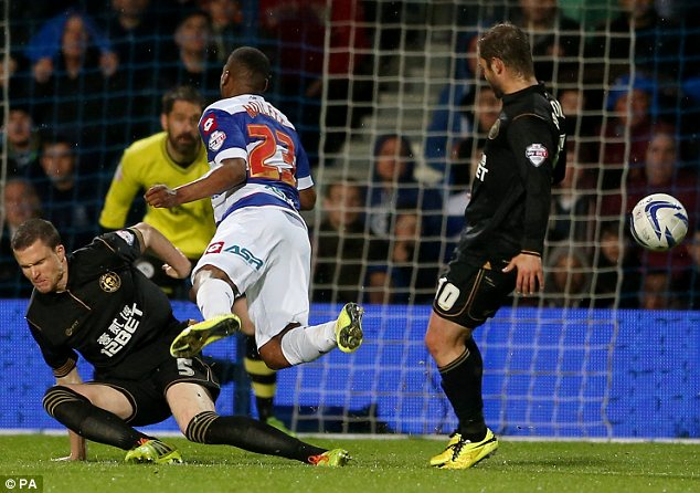Gary Caldwell brings down QPR forward Junior Hoilett to concede a penalty